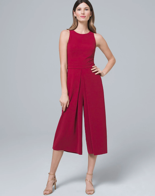 Blonde woman in a red sleeveless cropped pant culotte jumpsuit