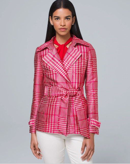 brunette woman in a red houndstooth cropped trench style jacket