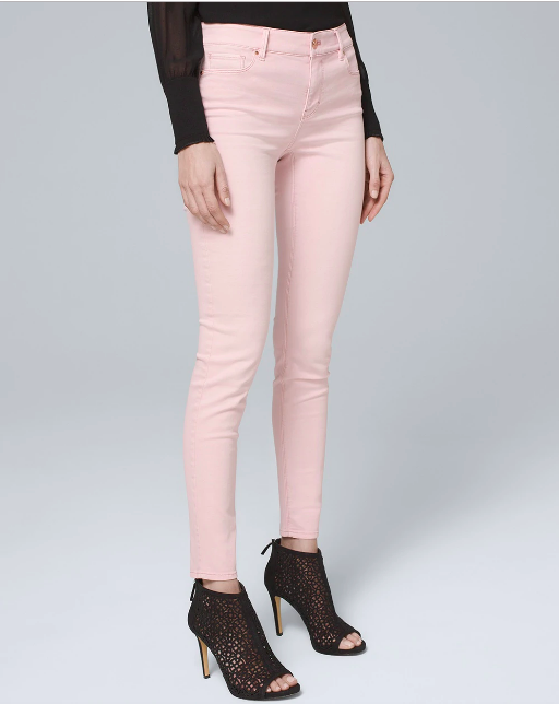 a woman in light pink skinny jeans