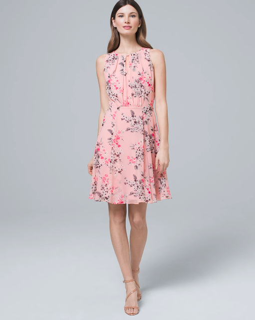 brunette woman in floral light pink pastel sleeveless dress