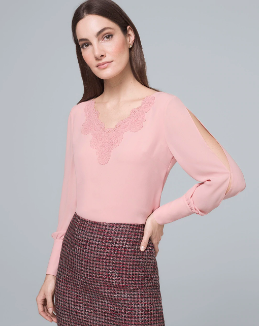 brunette woman in long sleeve pastel pink split-sleeve blouse with lace