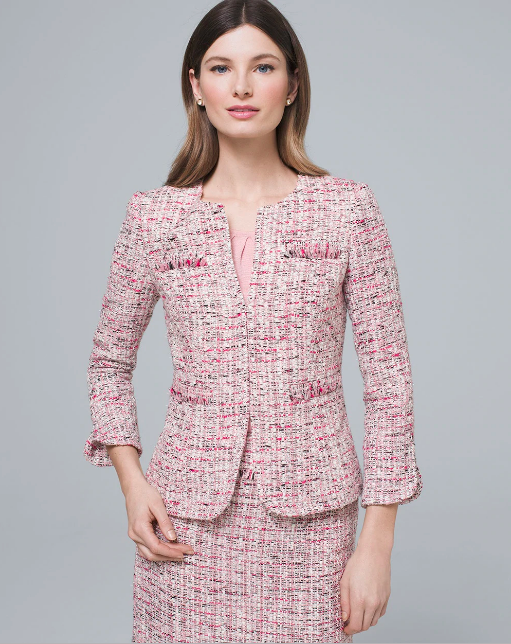 brunette woman in tweed pastel jacket
