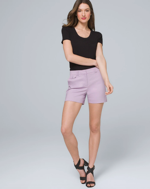 woman in five inch smooth front shorts in lavender