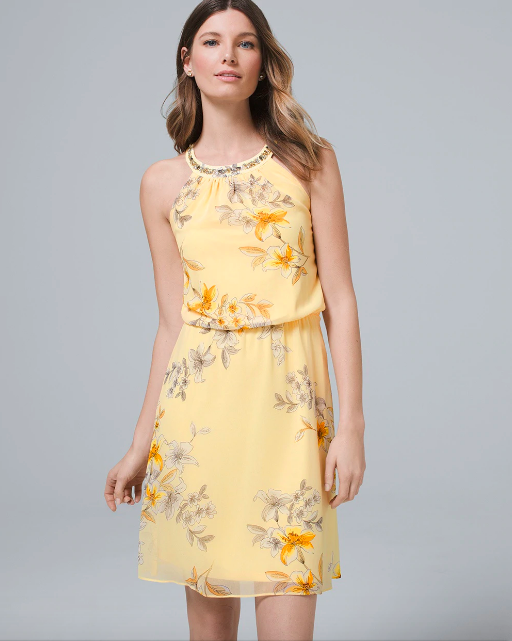 woman in sleeveless yellow floral dress with embellished neck
